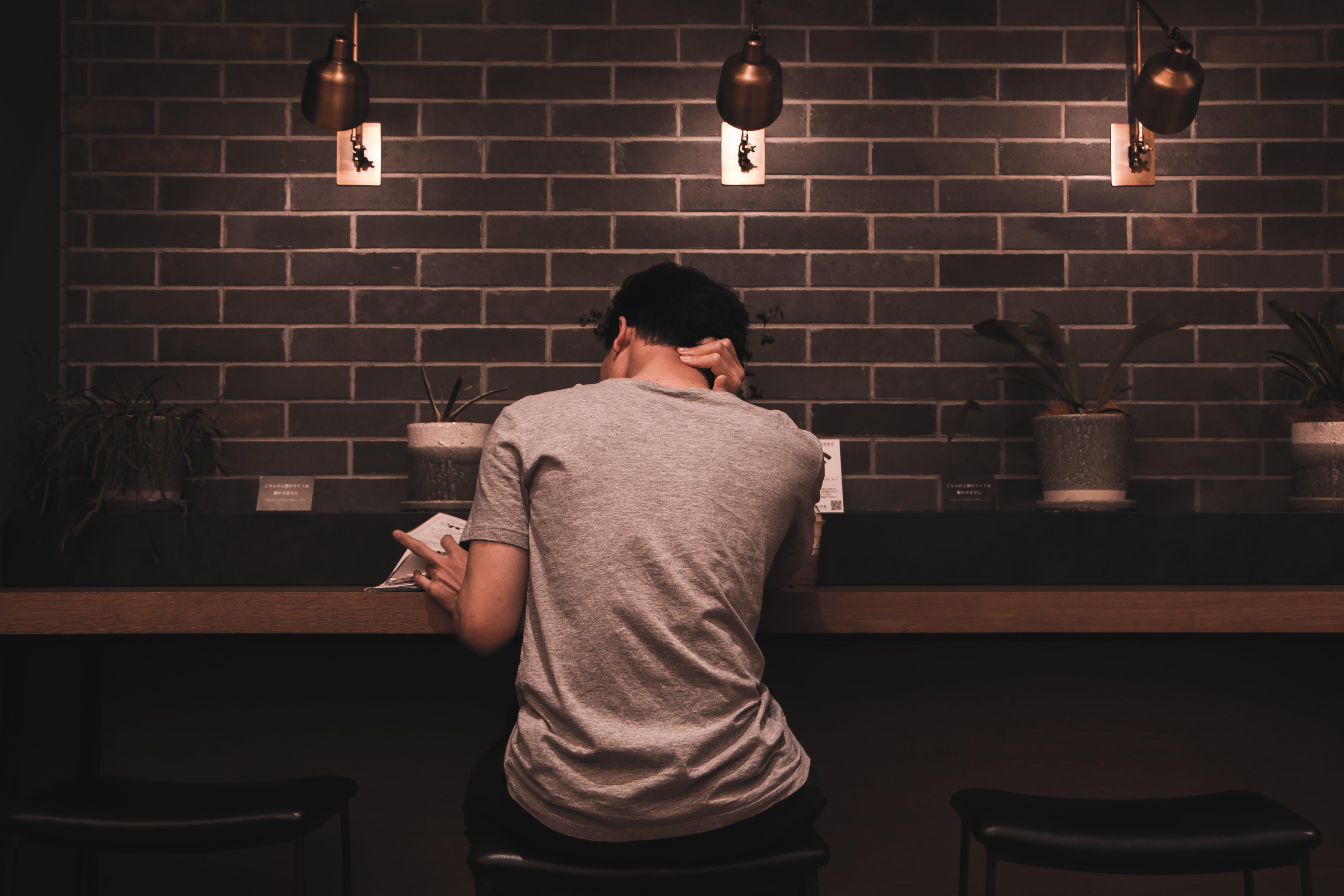 Man Sitting Reading Book