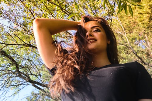 Low Angle View of Woman Holding Her Hair