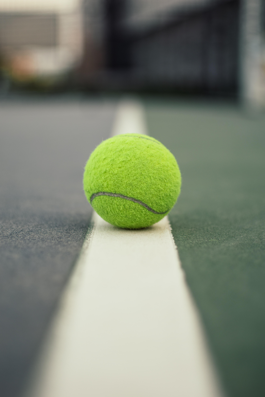 Green Tennis Ball On Court Free Stock Photo