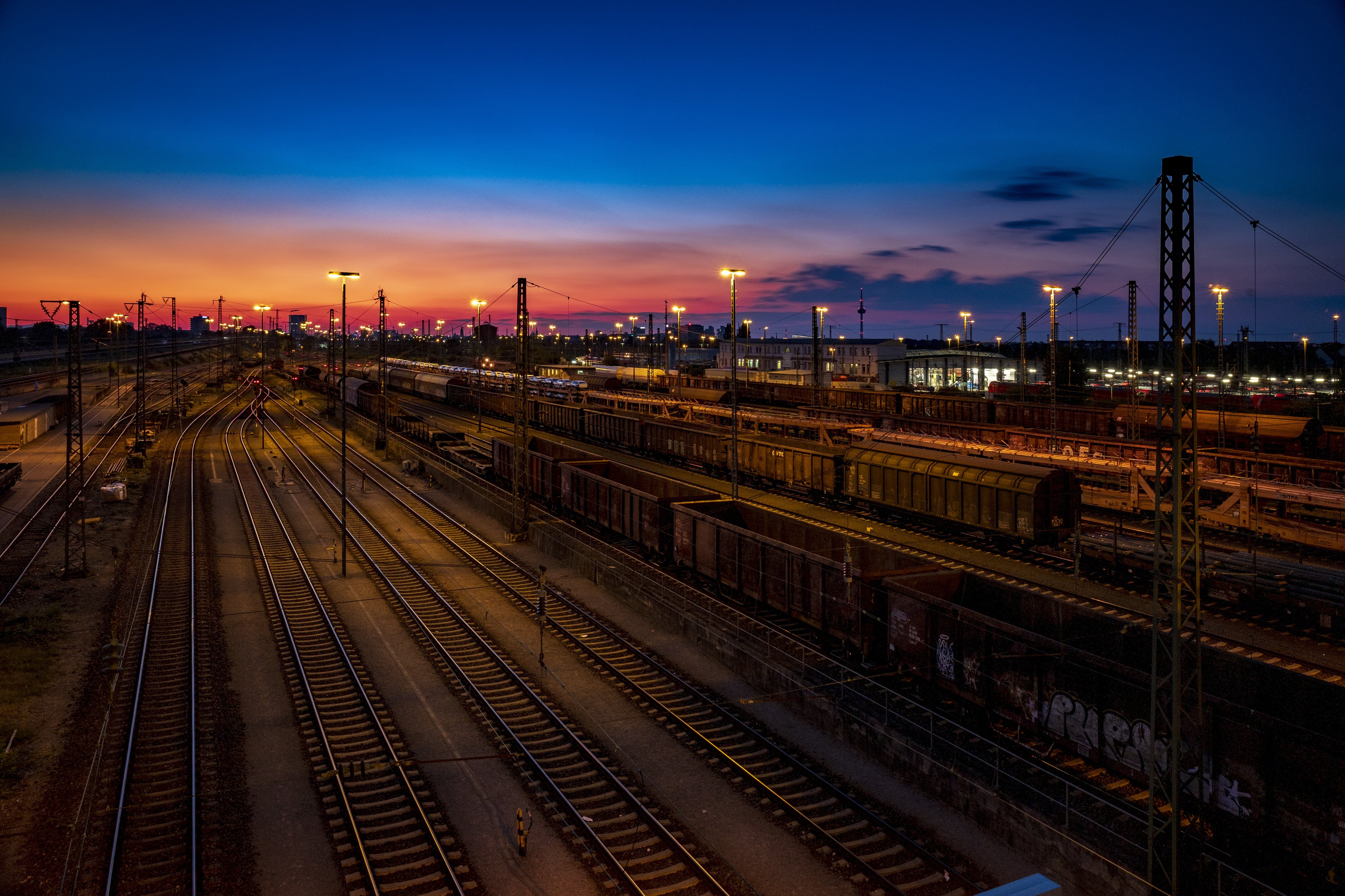 Aerial Photo of Train Rails Under Golden Sky