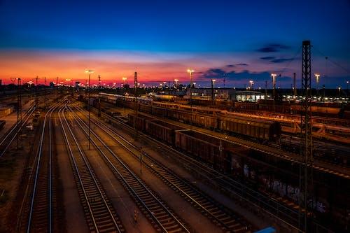 Aerial Photo of Train Rails Under Golden Sky