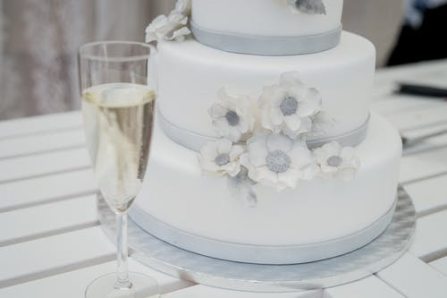 White Fondant Icings And Champagne Flute Glass
