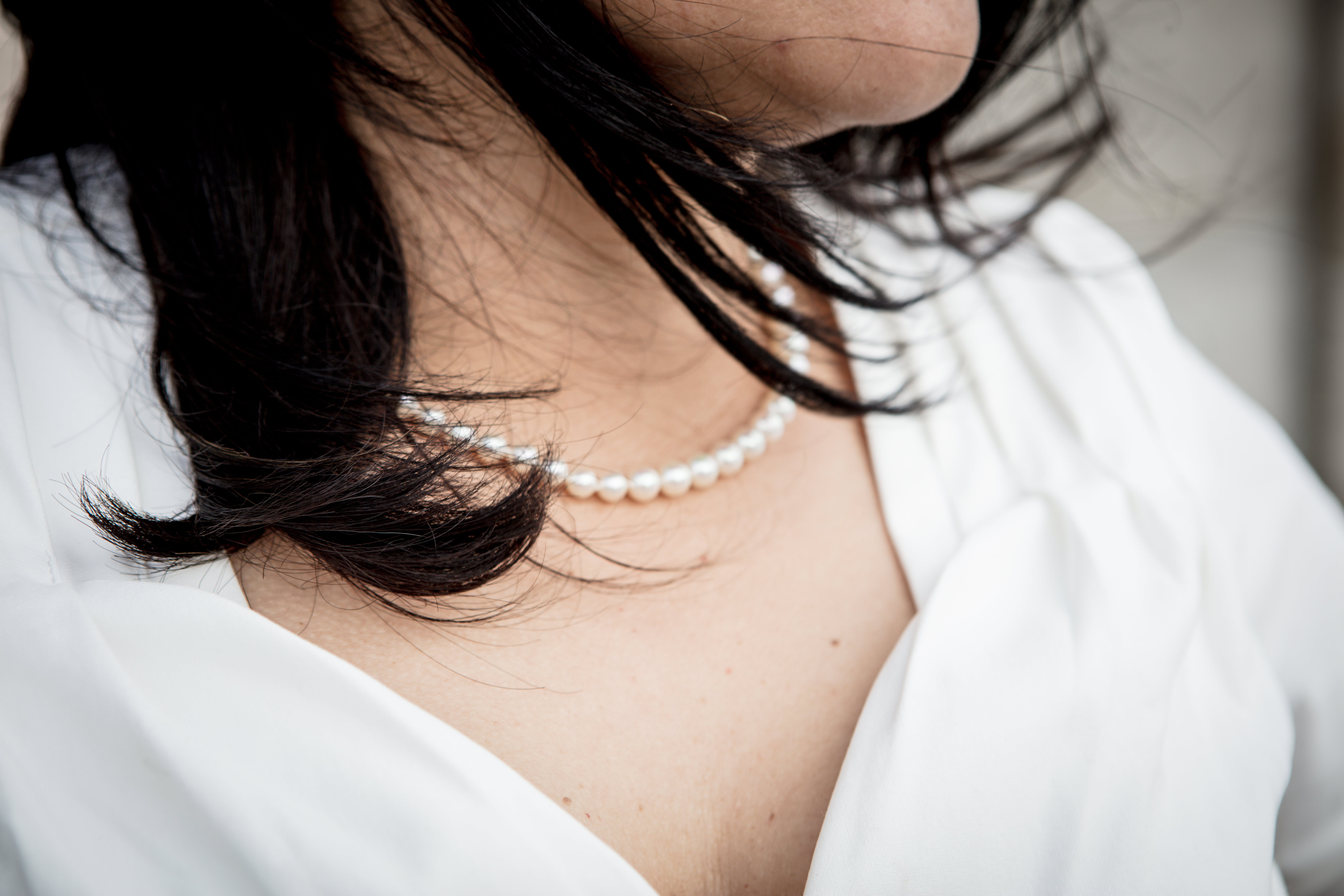 Close-up Photo Of Woman Wearing Beaded White Pearl Necklace