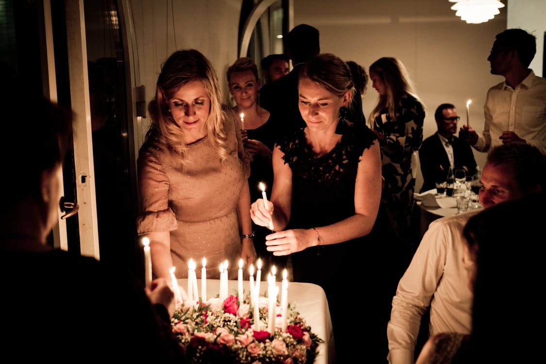 Two Women Holding Candles