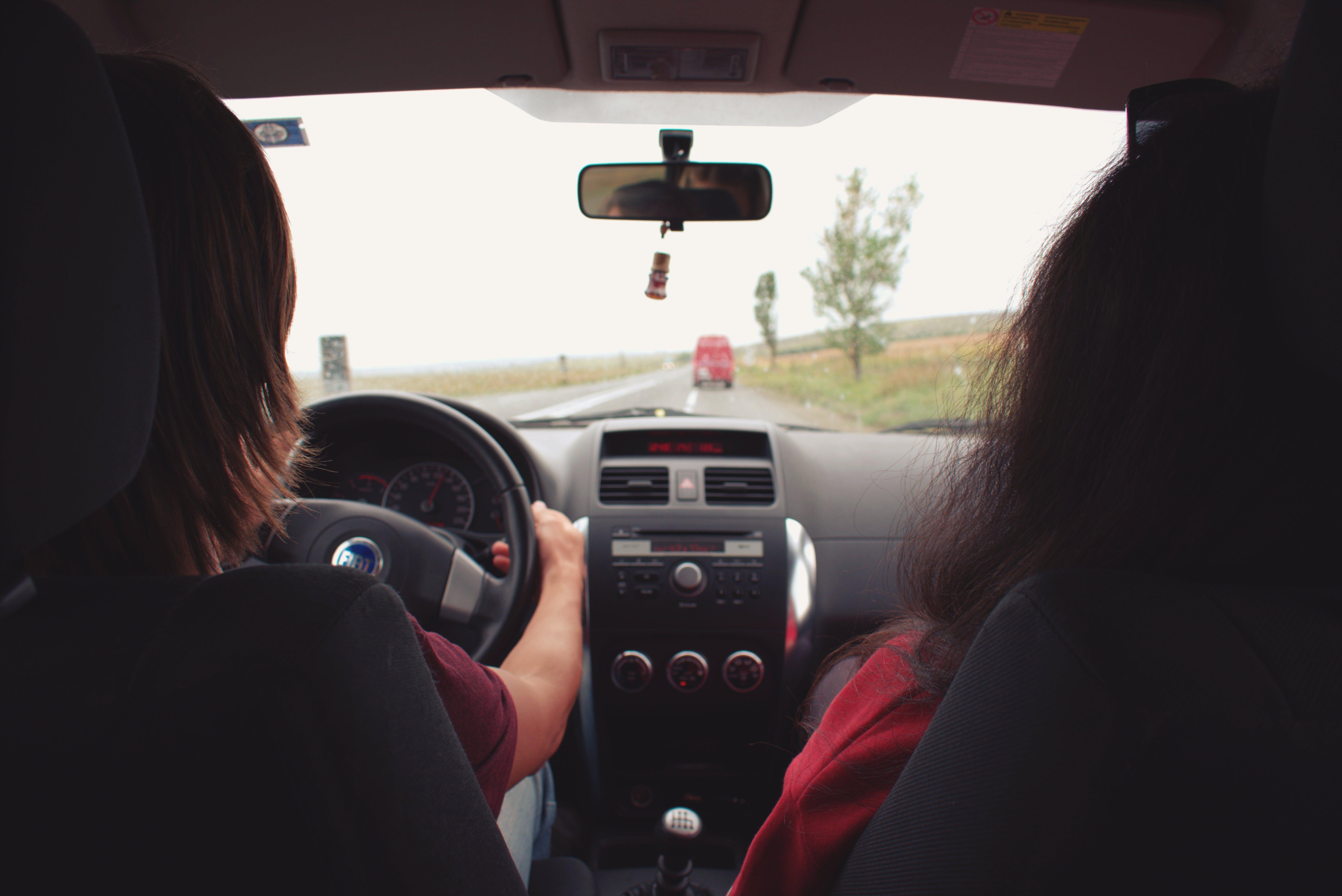 Two Woman Sitting Inside Vehicle