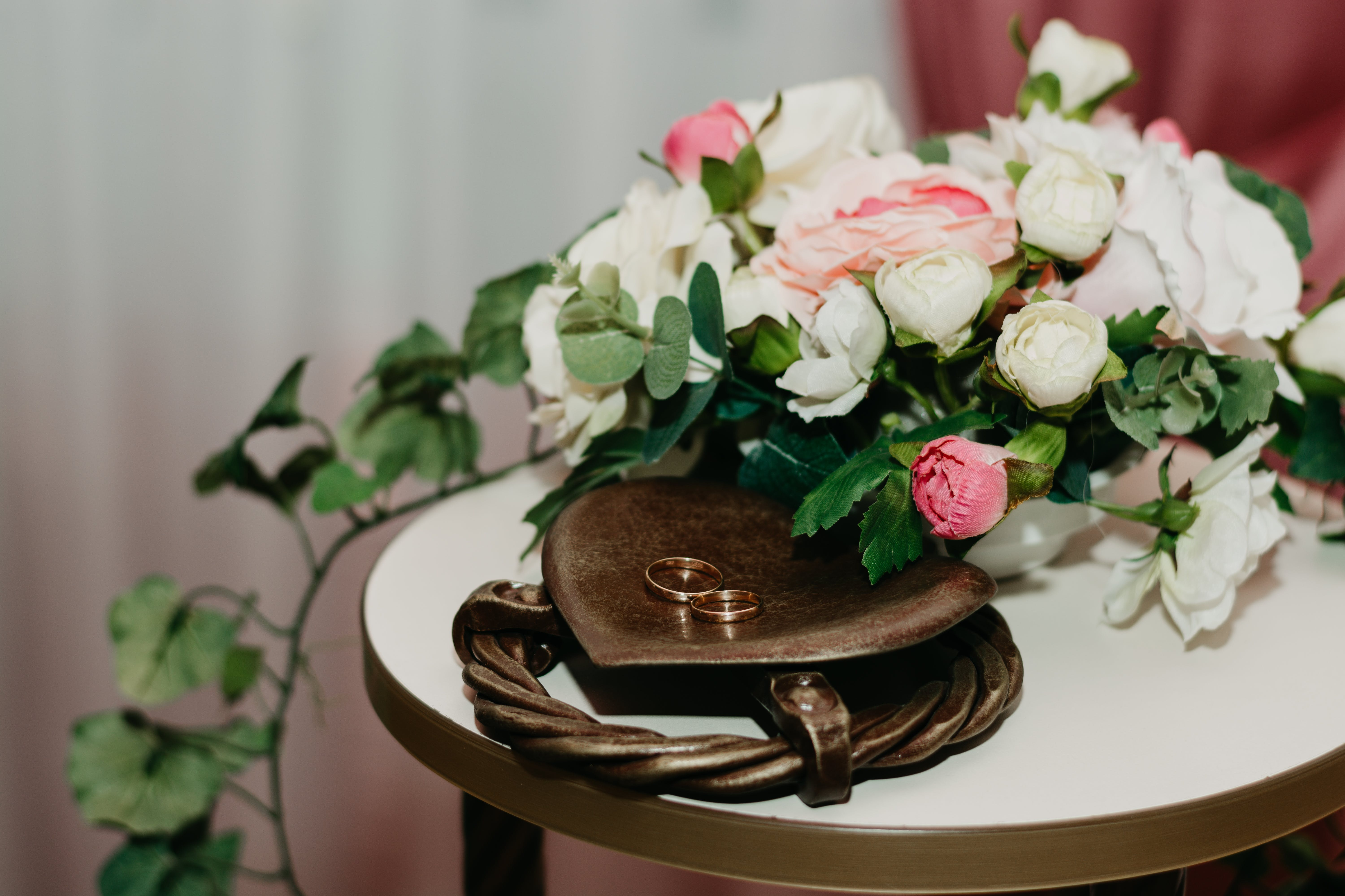 Two Gold Rings Near White And Pink Flowers