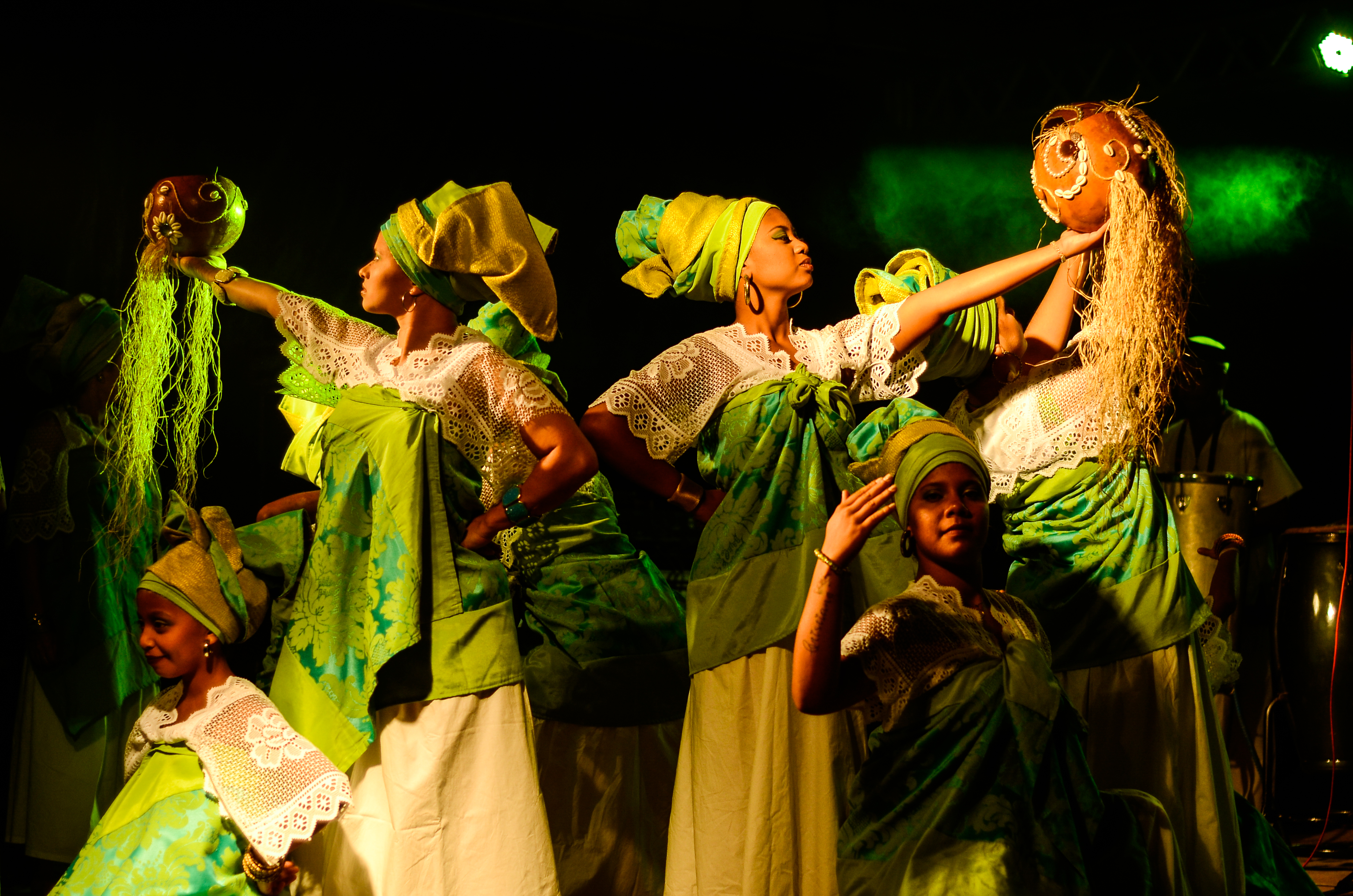 Group of Women Wearing Green-and-white Dresses