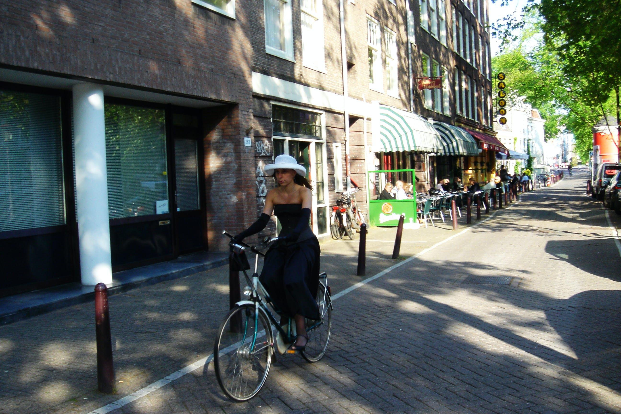 Free stock photo of amsterdam, bike, bike rider, buildings