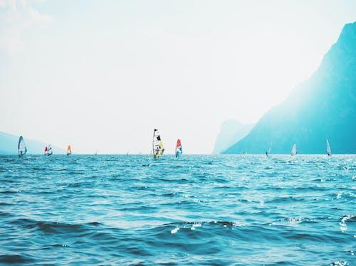 Sailboats on Sea Near Mountain