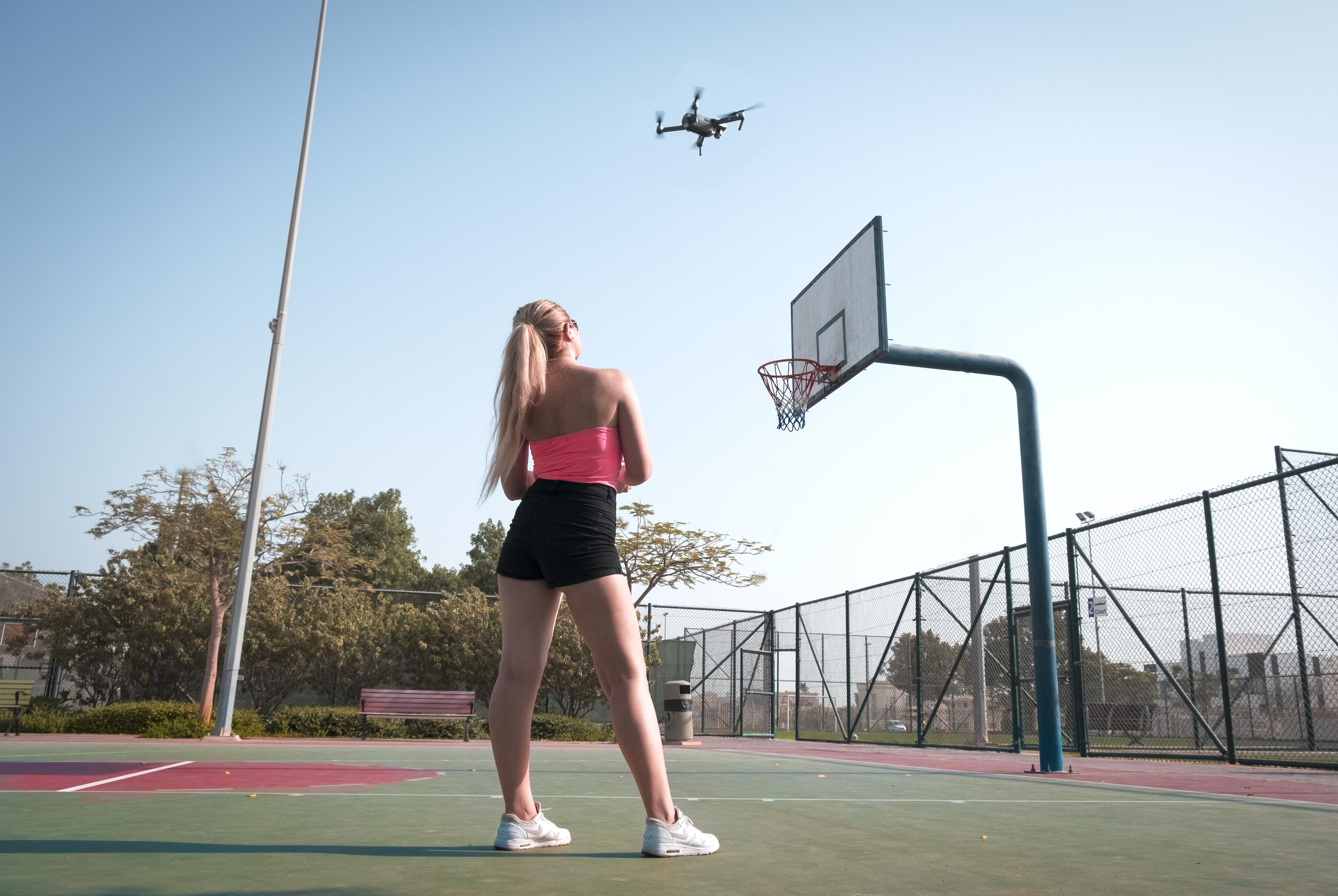 Woman Standing Near Basketball Hoop