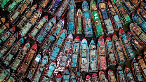 Foto profissional grátis de aerofotografia, barcos, barcos de pesca, cheio de cor