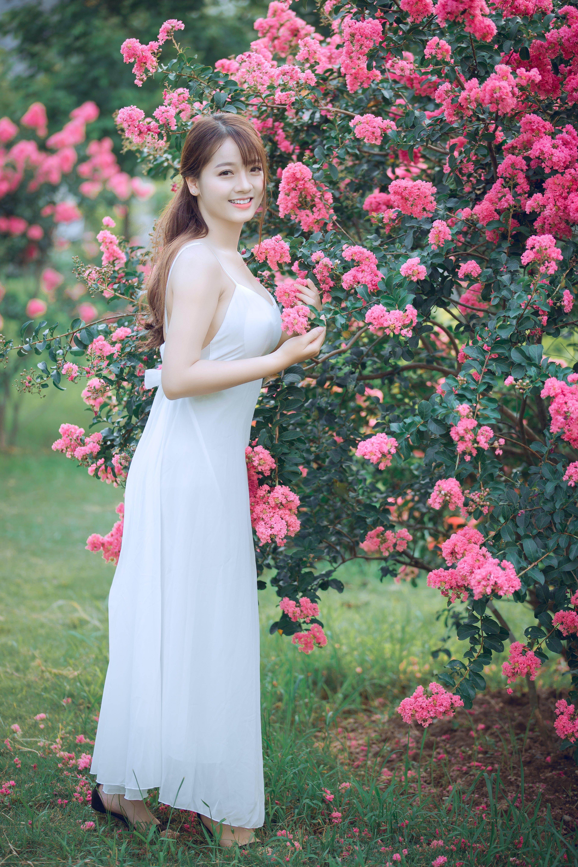 Woman in Dress Standing Beside Tree
