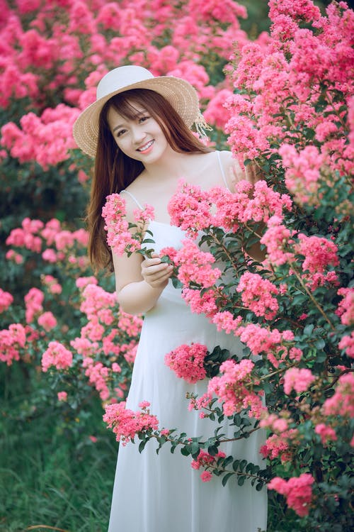 Woman Behind Pink Flowers