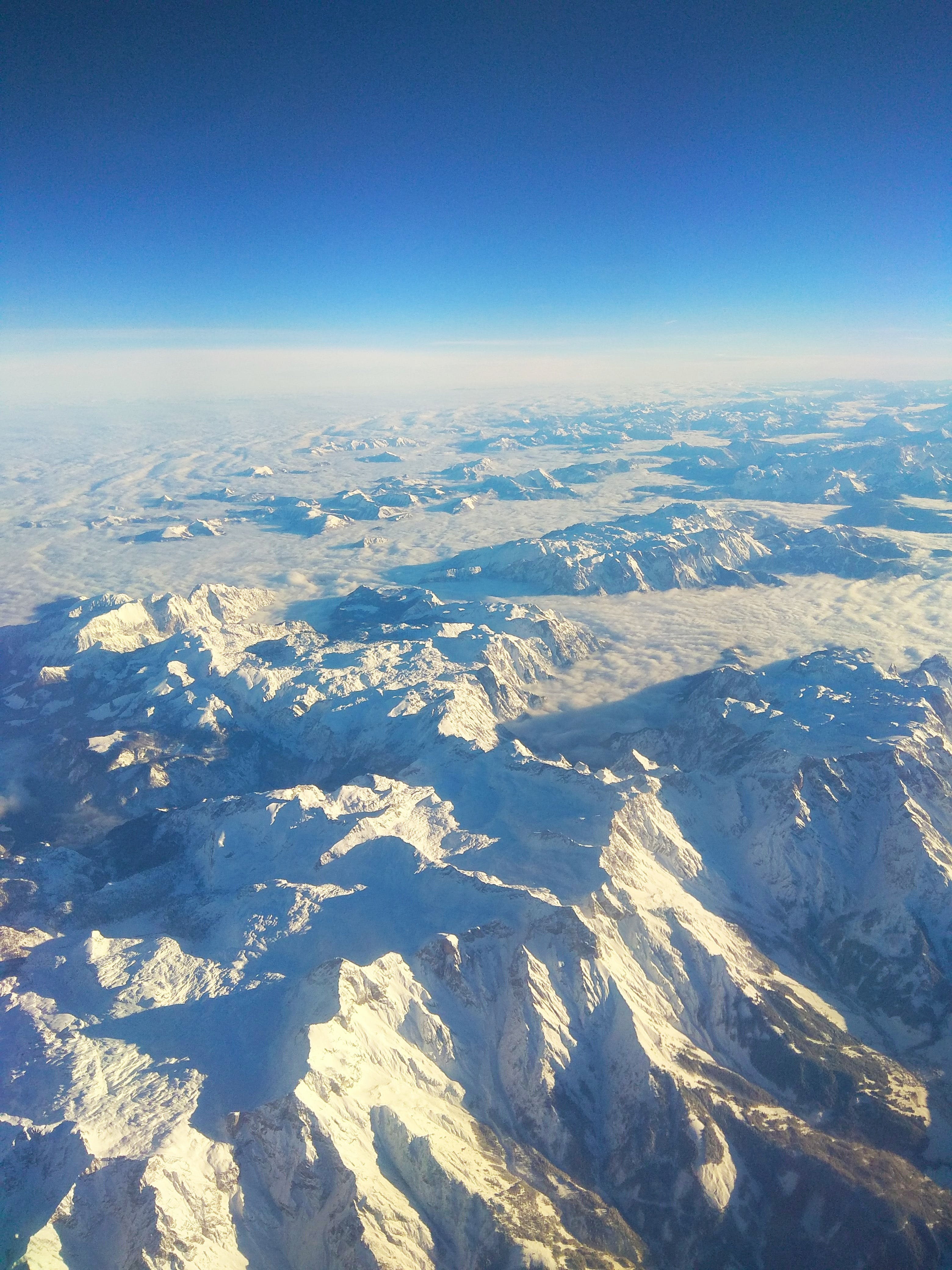 Aerial View of Snow-covered Mountains