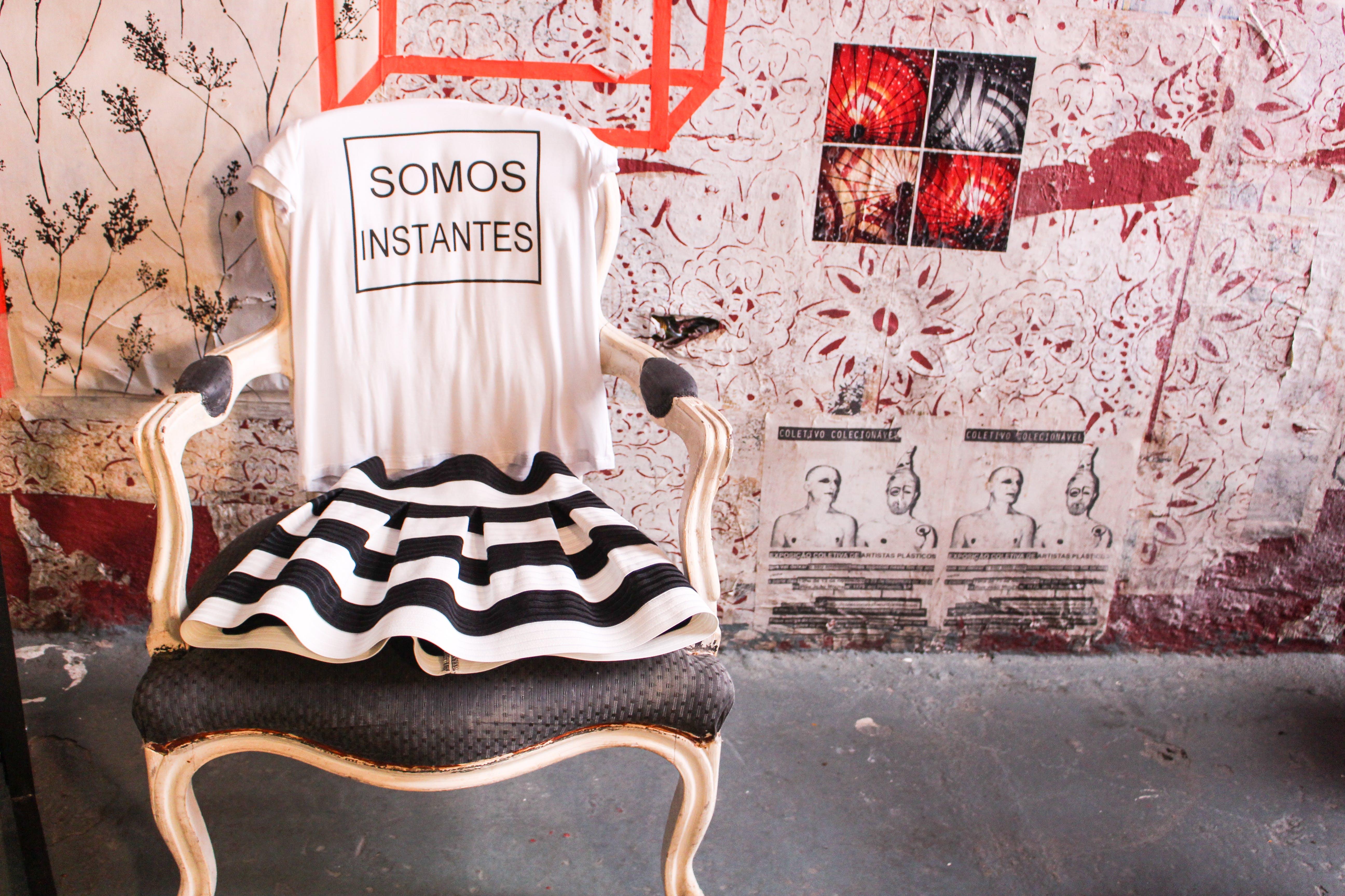 White T-shirt on Chair Near Wall