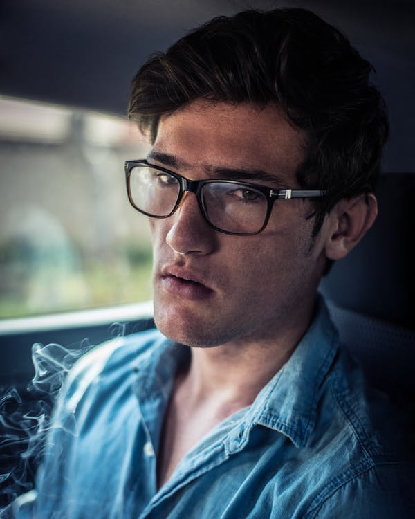 Close-Up Photography of Man Wearing Eyeglasses