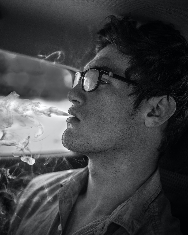 Monochrome Photography of Man Smoking