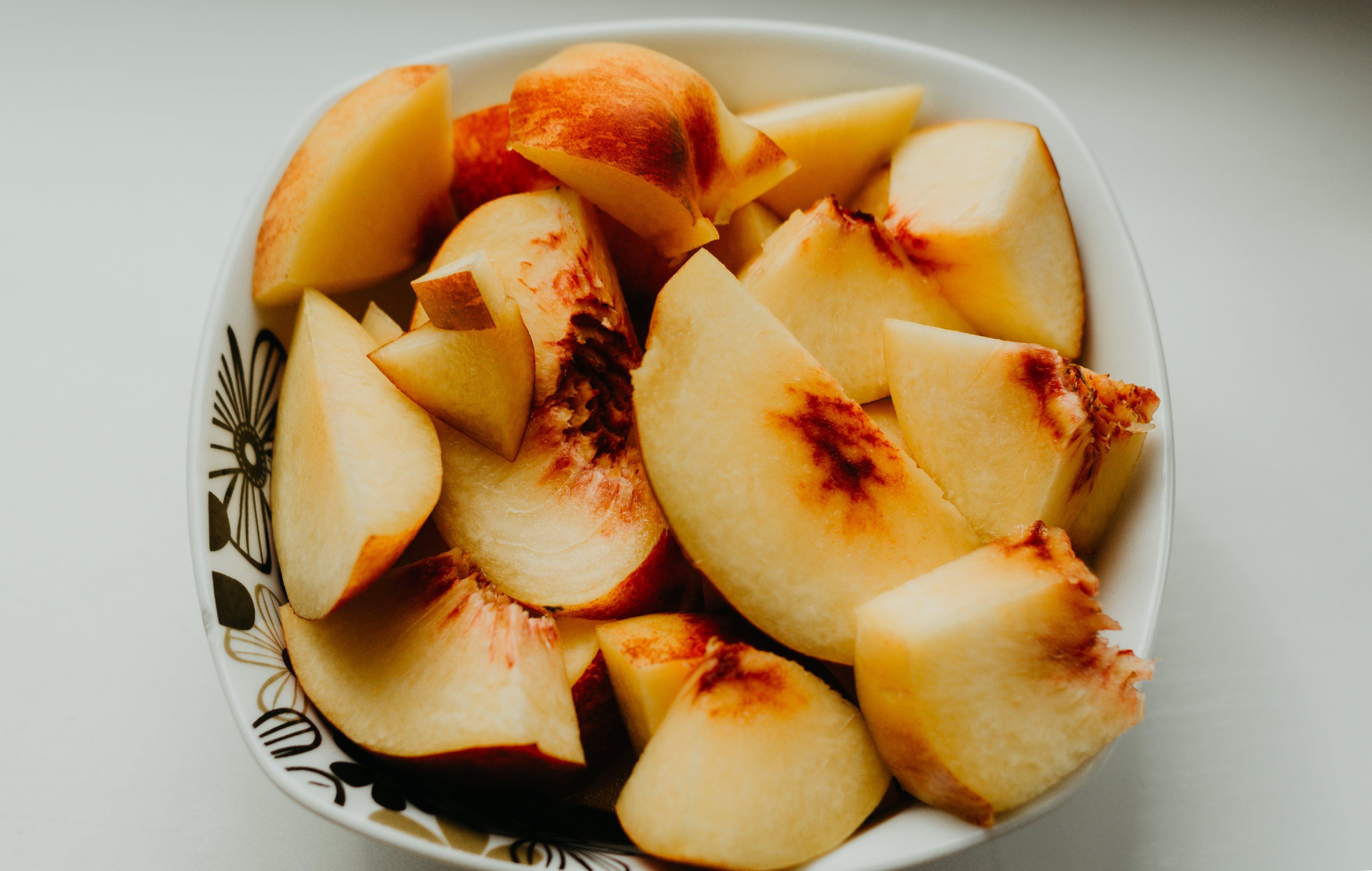 Sliced Apples on White Ceramic Bowl
