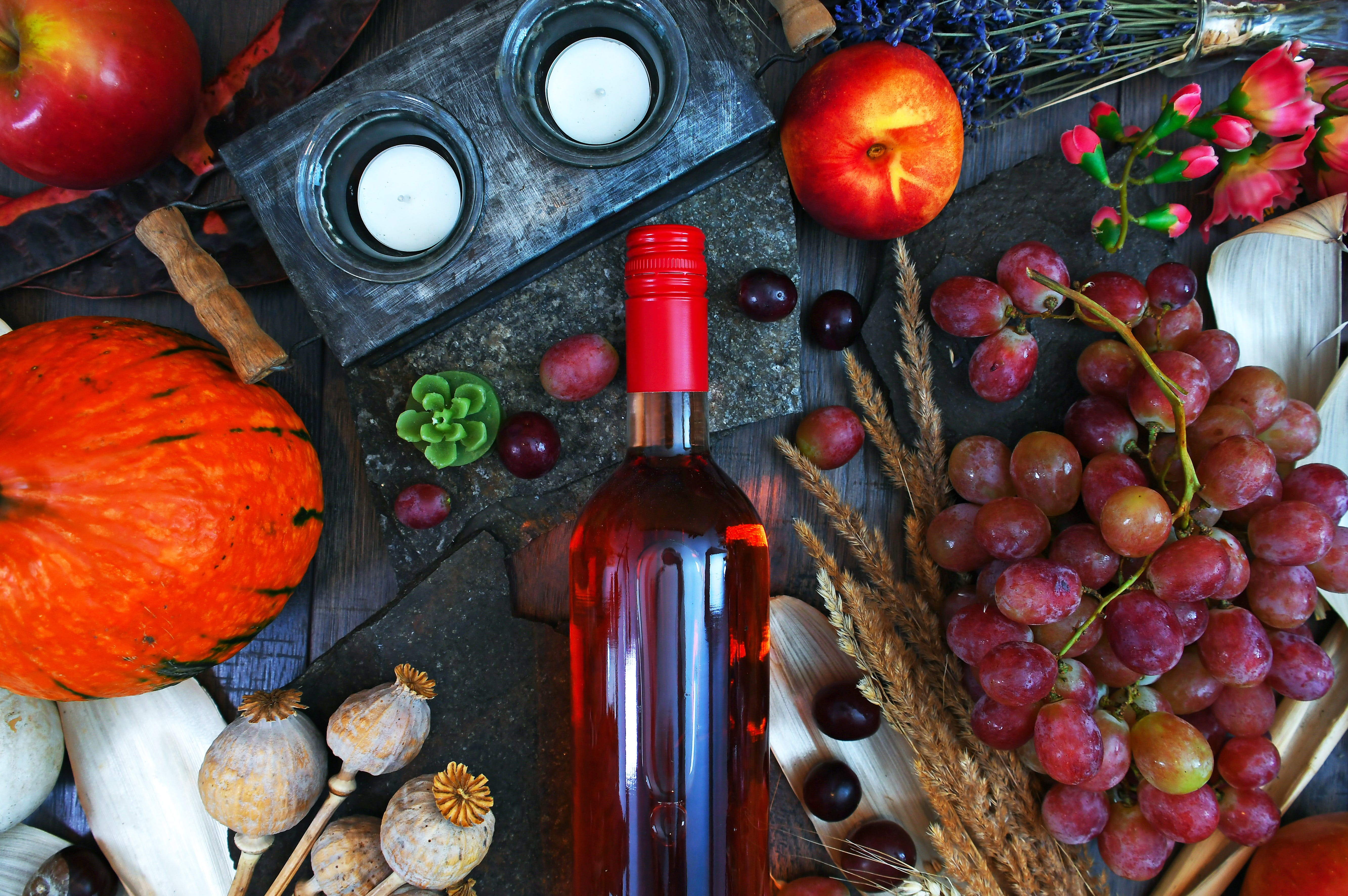 Clear Glass Wine Bottle Surrounded by Fruits Top View Photography
