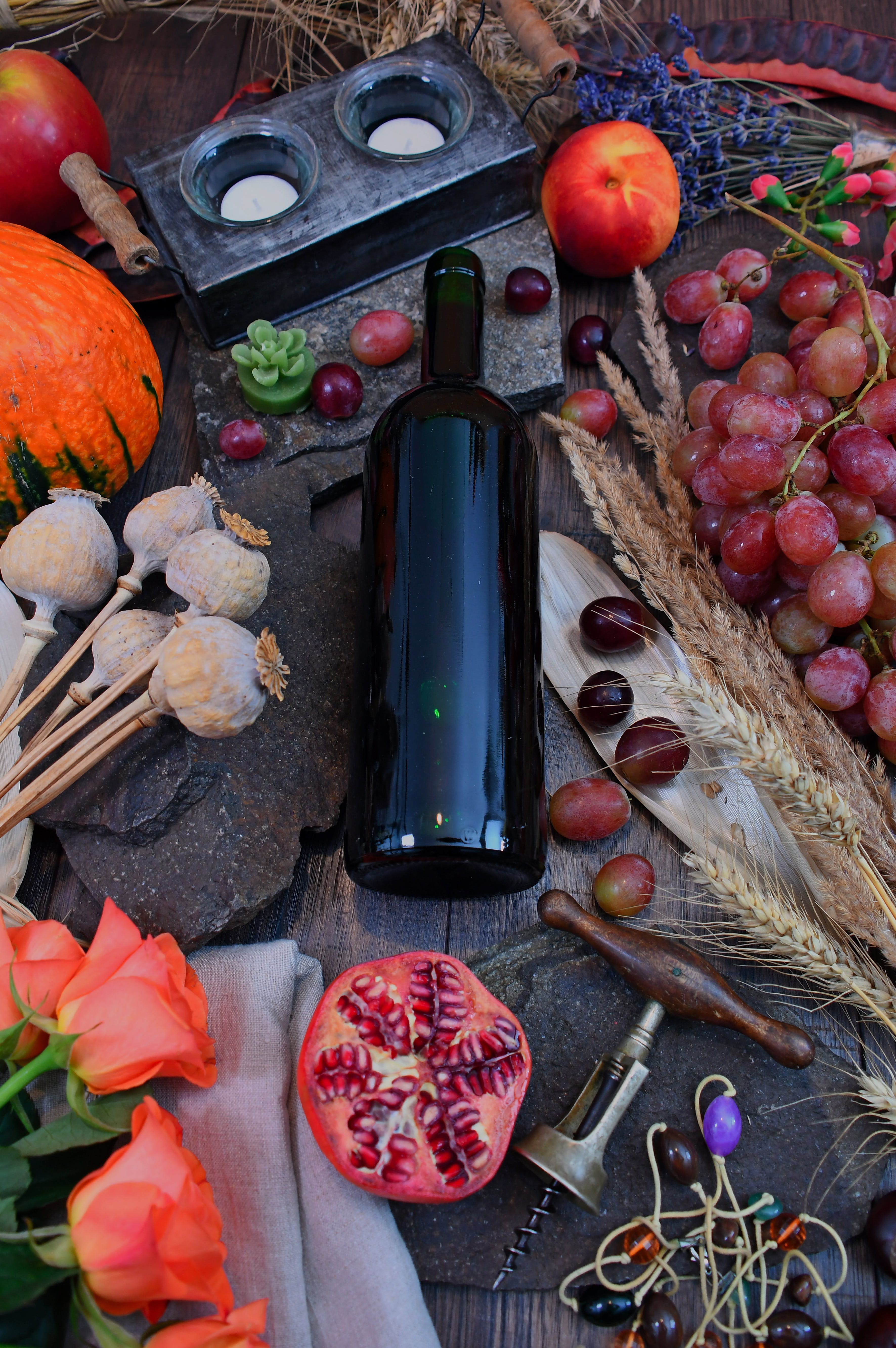 Wine Bottle Surrounded With Vegetables and Fruit on Brown Wooden Surface