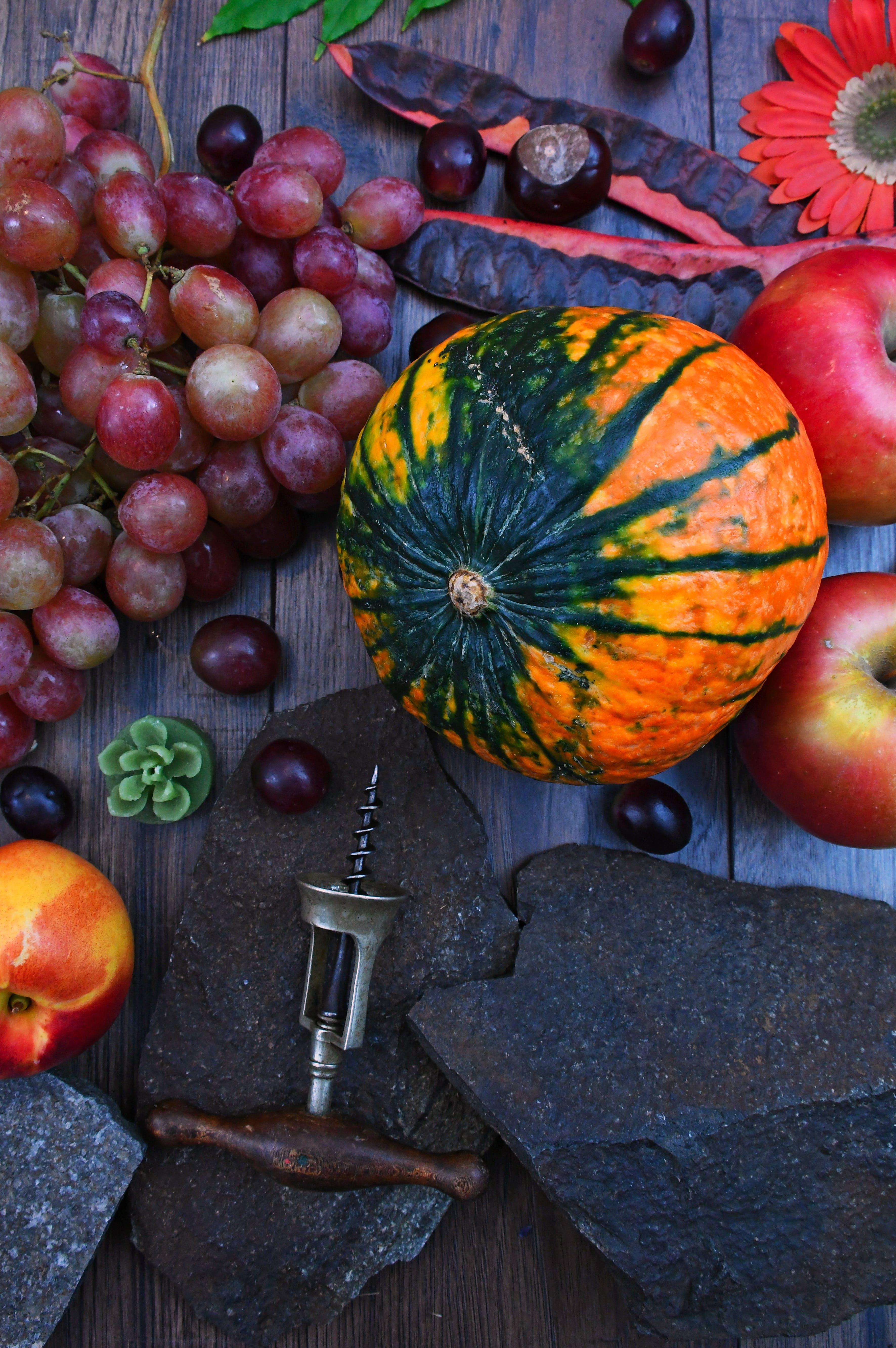 Orange Pumpkin Near Apples and Grapes
