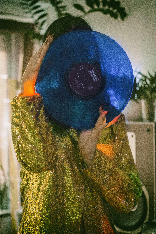 Woman Holding Blue Vinyl Record