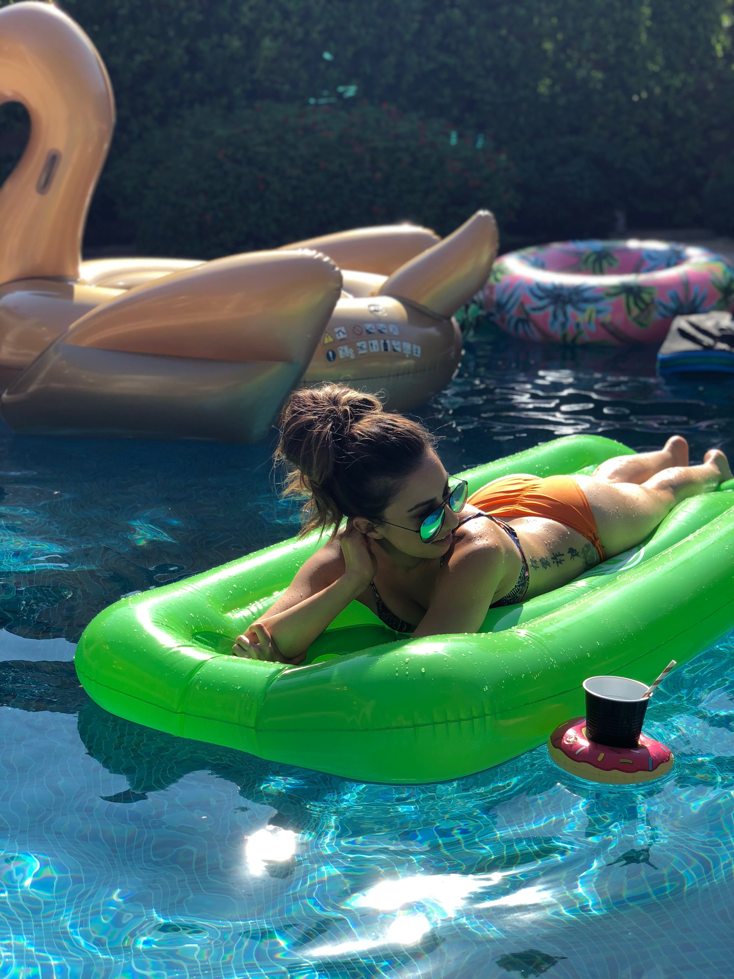 Photo of Woman on Top of Green Floater