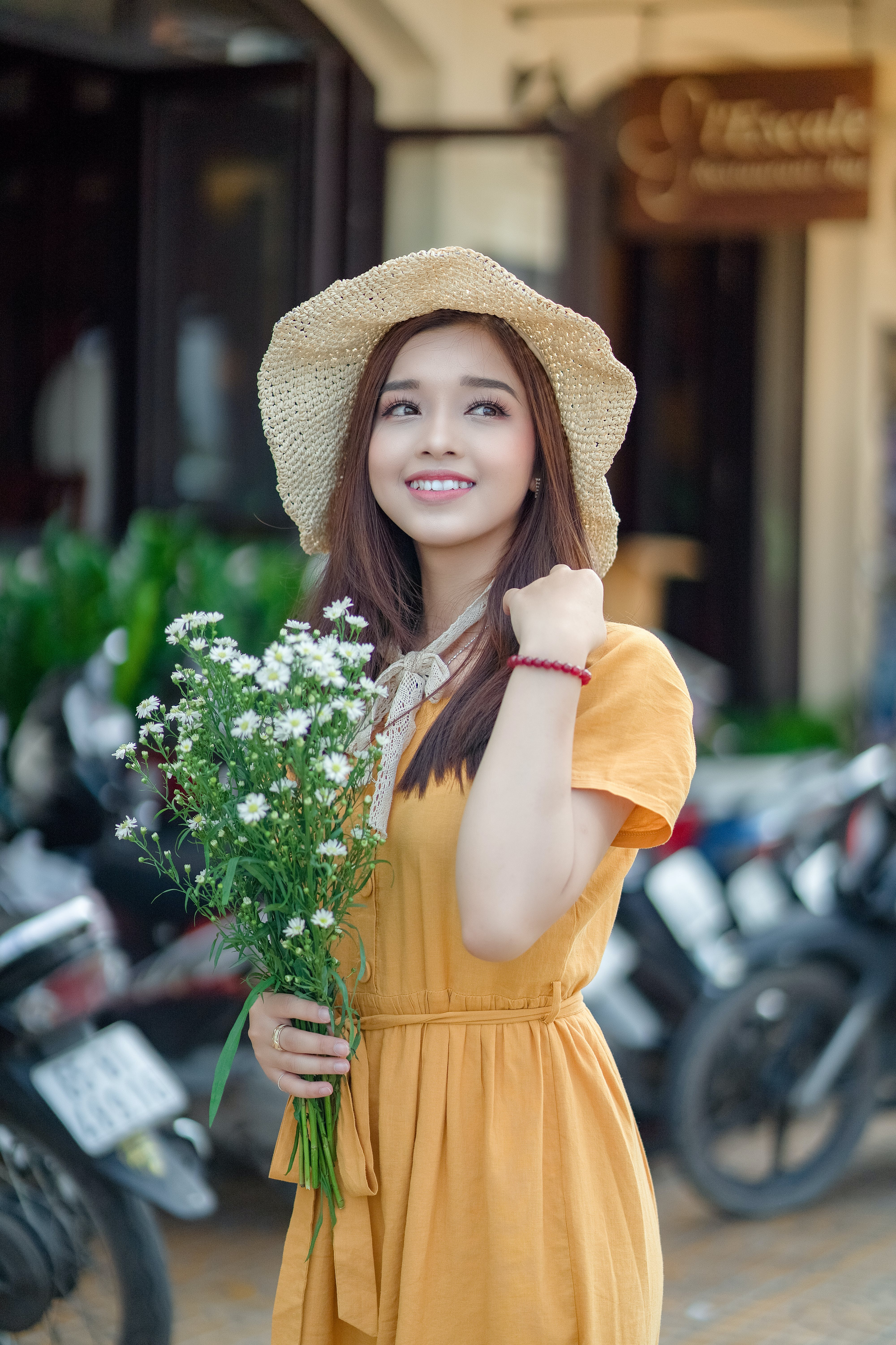 Selective Focus Photo Of A Woman Holding Flowers