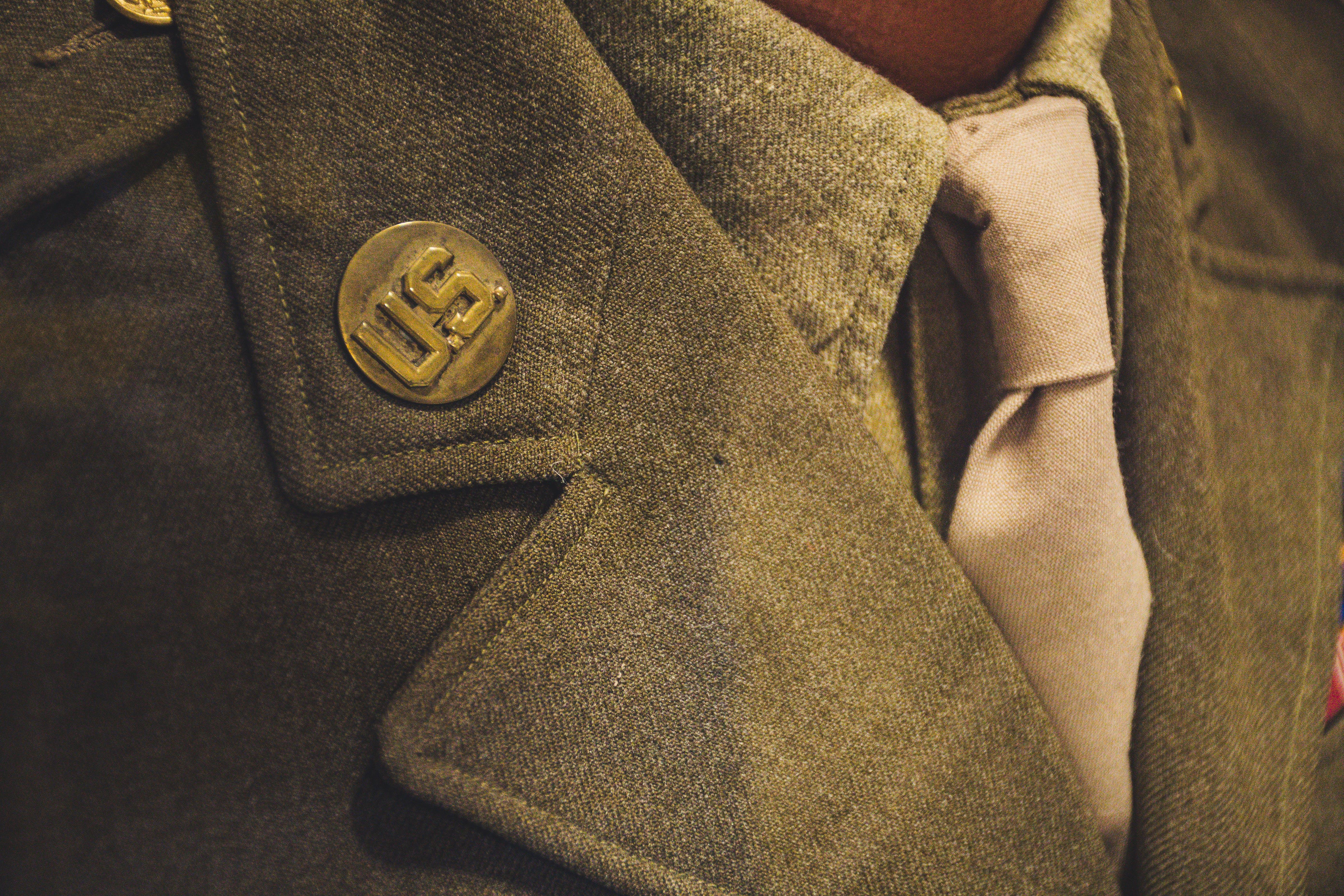 Brown Notched Lapel Suit Jacket Close-up Photo