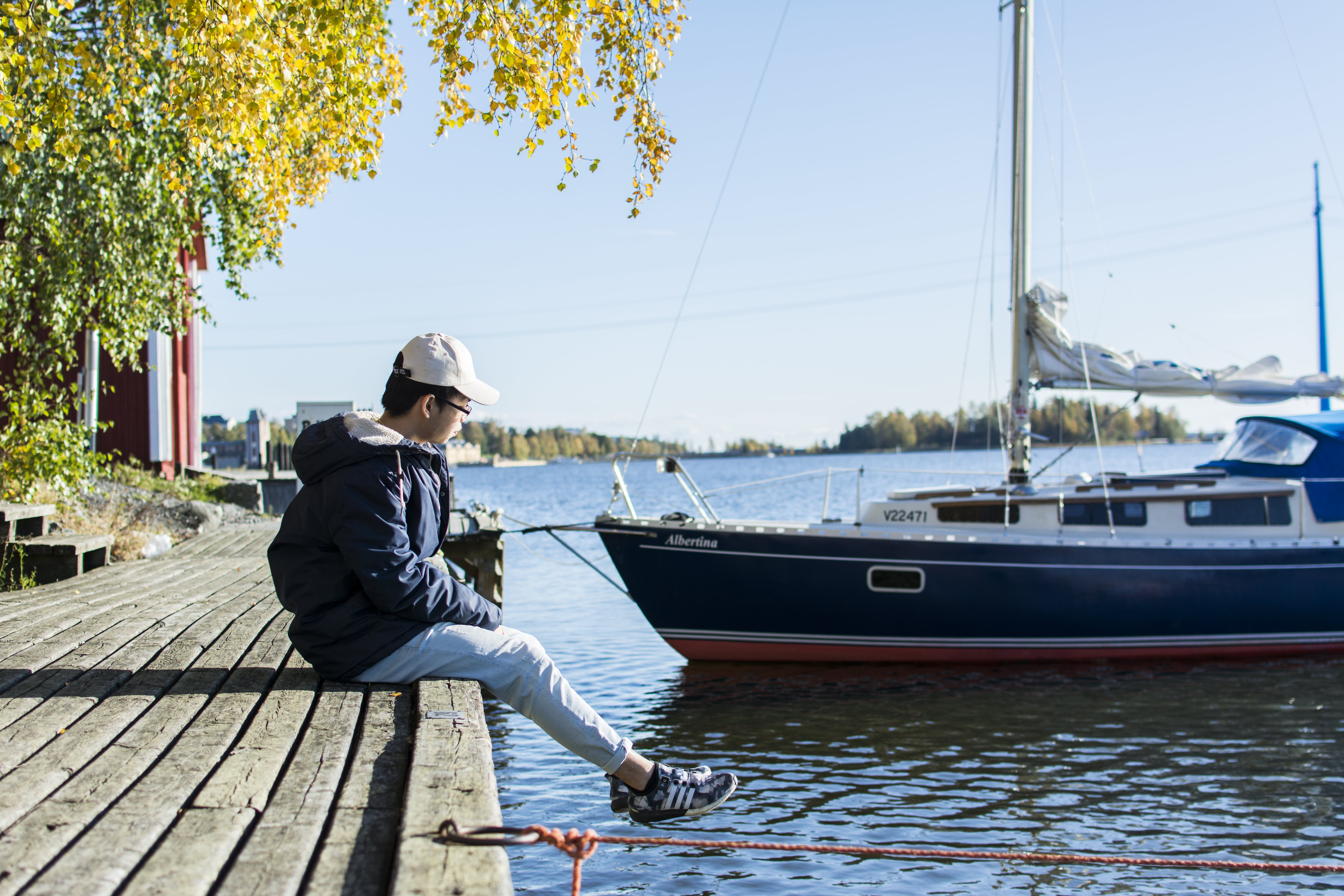 Person Sitting On Dock