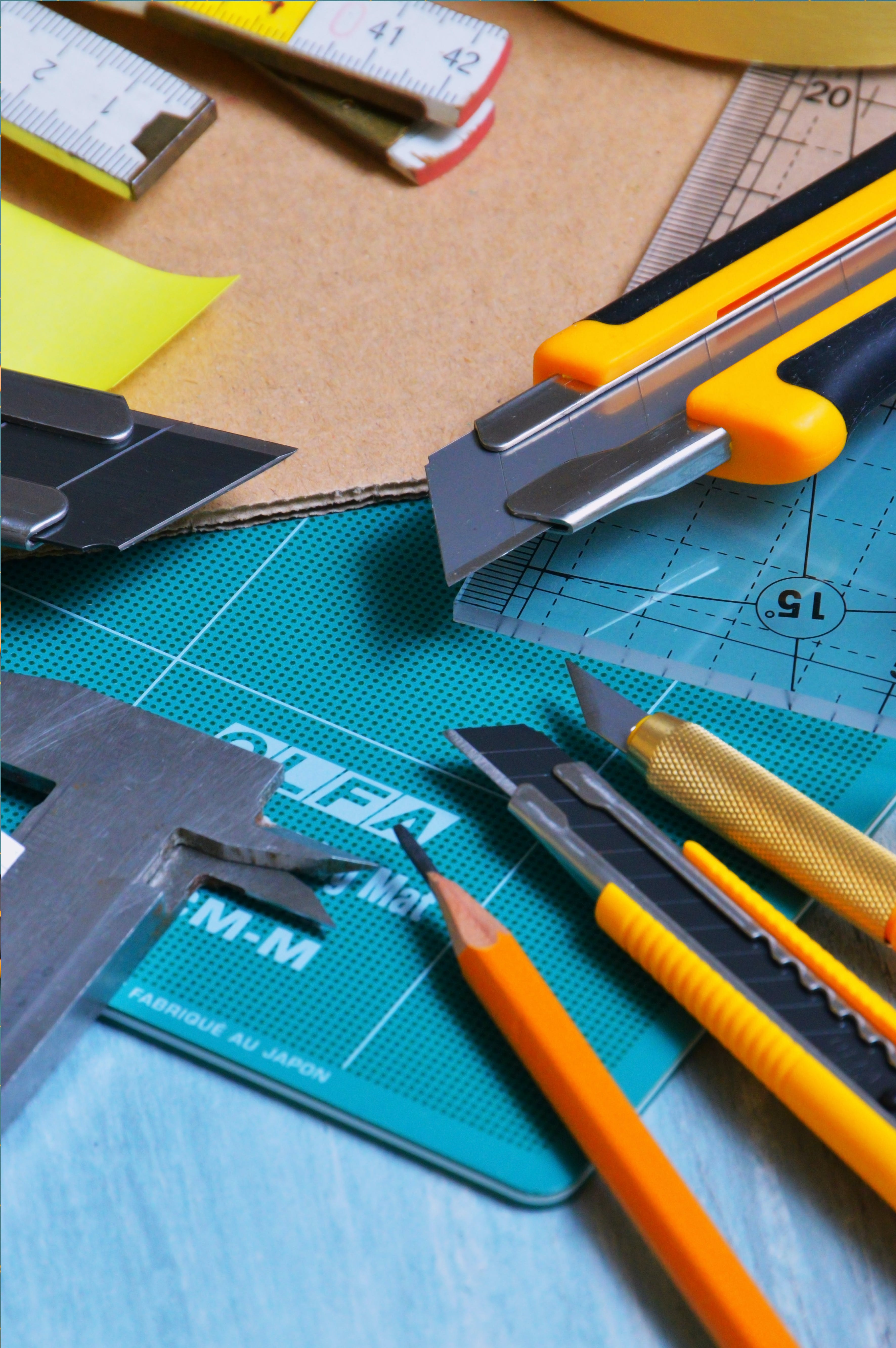 Close-up Photography Pencil and Cutters on Table