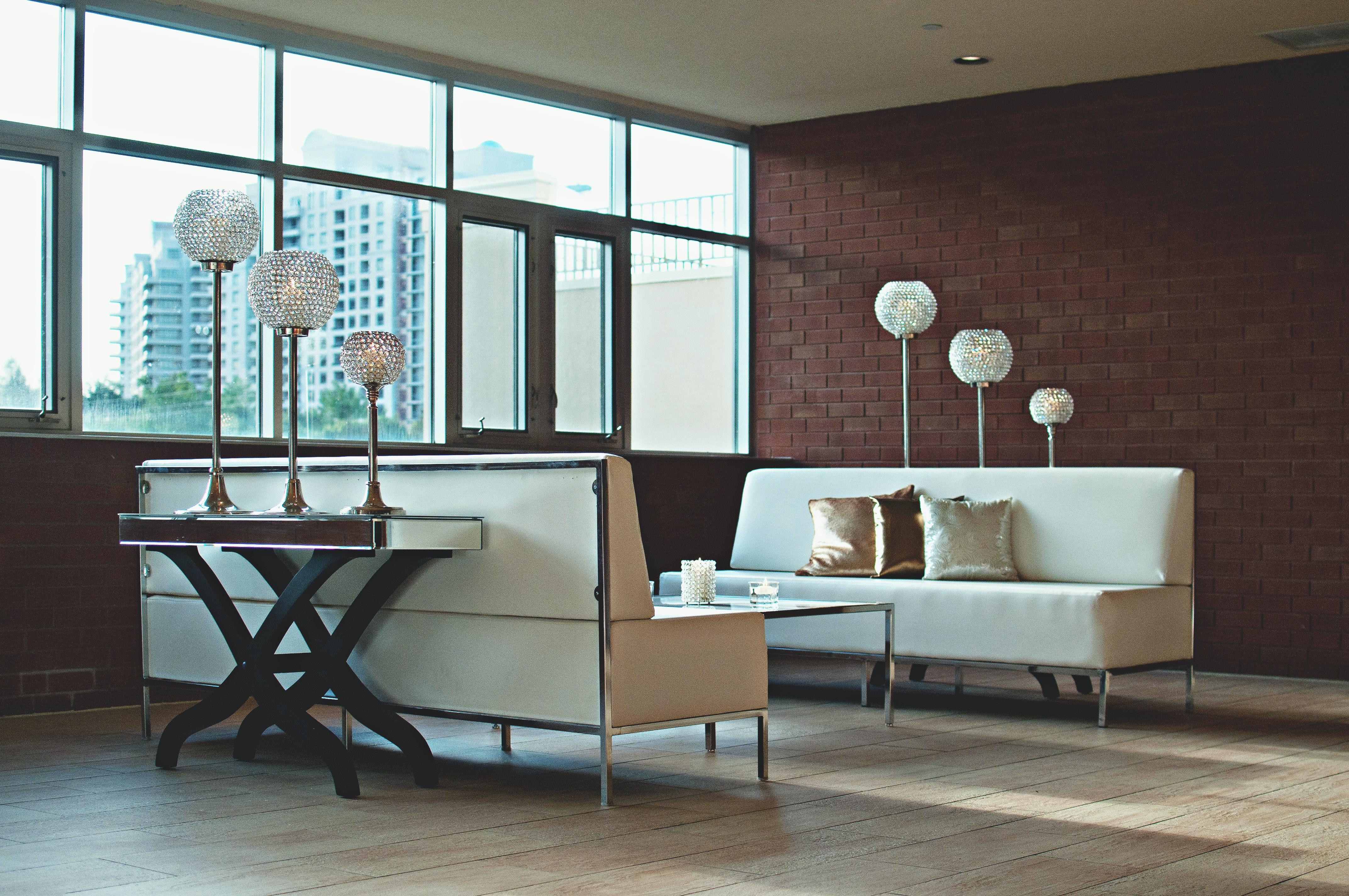 Grey Throw Pillow On White Sofa Near The Window Free Stock Photo
