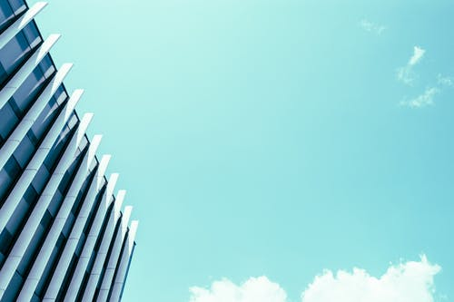 High Rise Building Under White Clouds and Blue Sky