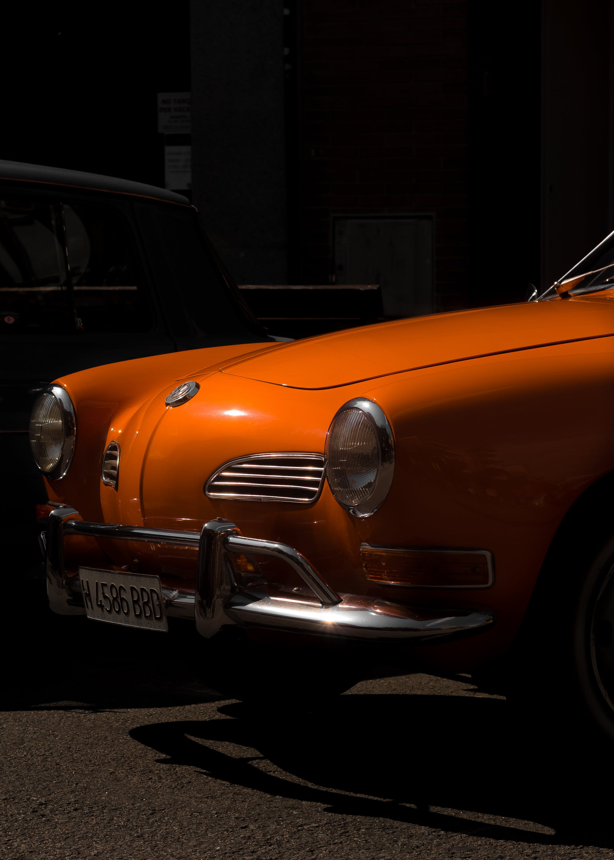 Orange Volkswagen Karmann Ghia Near Building