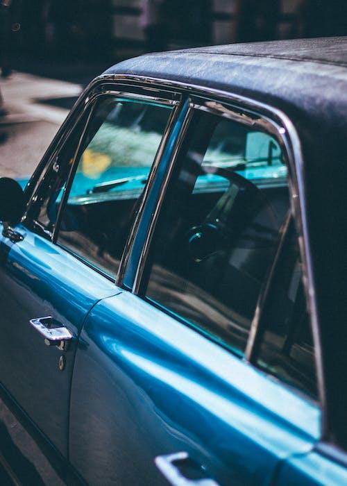 Close-up Photo of Blue Sedan