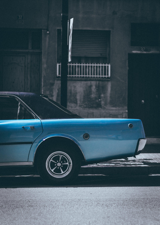 Classic Blue Sedan Parked On Roadside