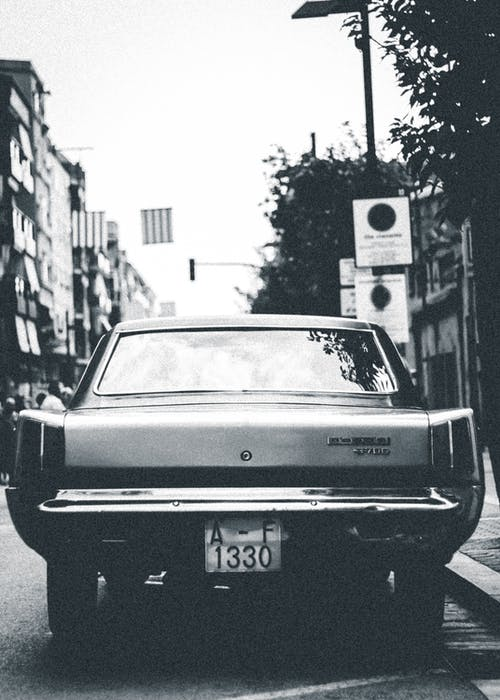 Grayscale Photo Of Vehicle Parked