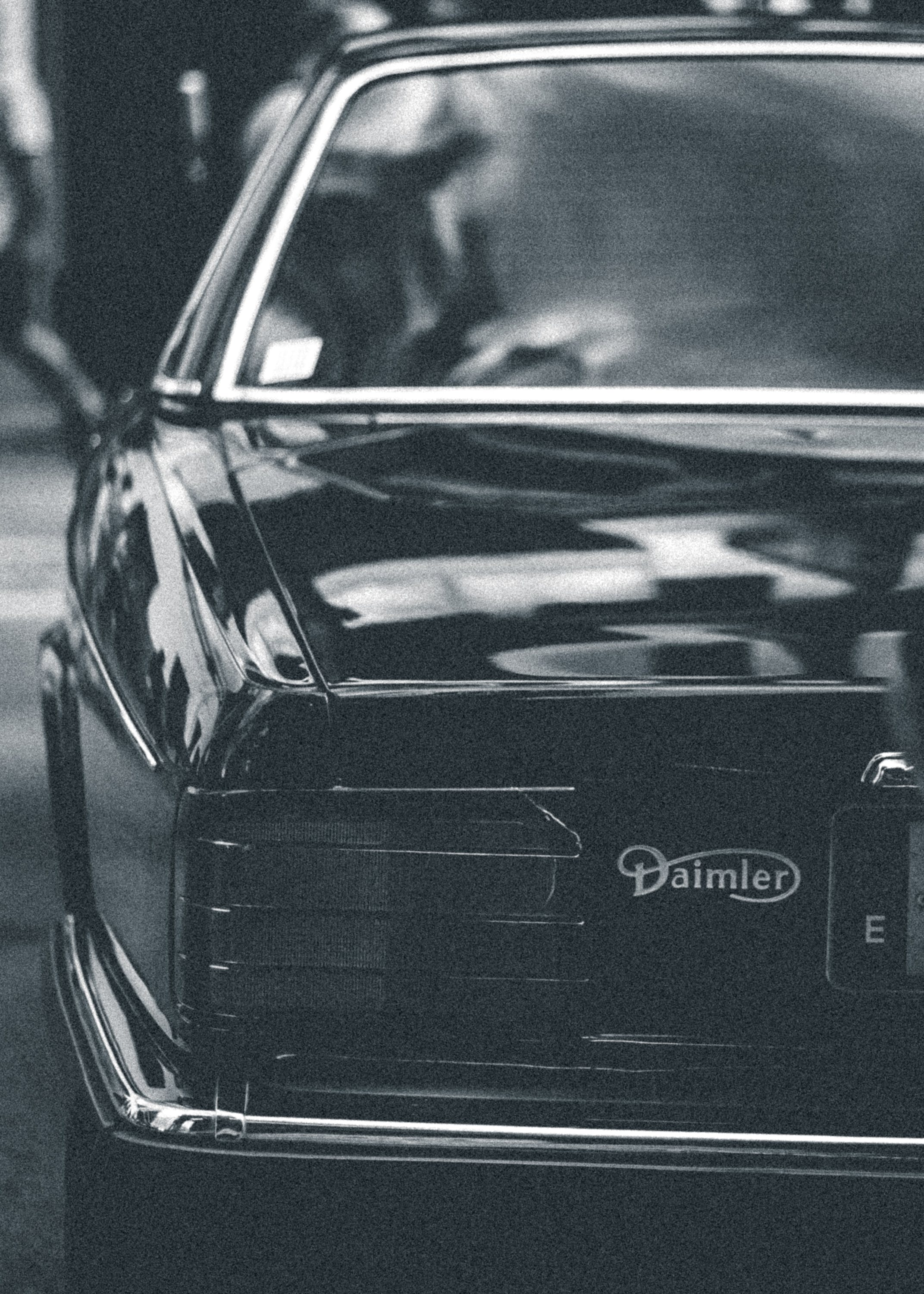 Grayscale Photo of Daimler Car