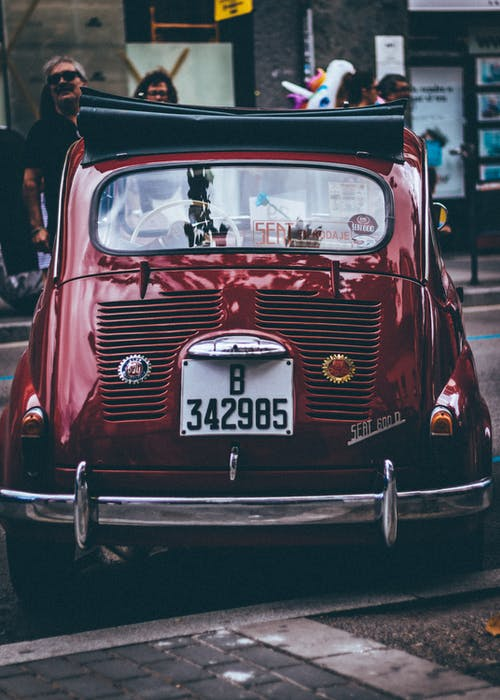 Photo of a Vintage Car Parked on Street