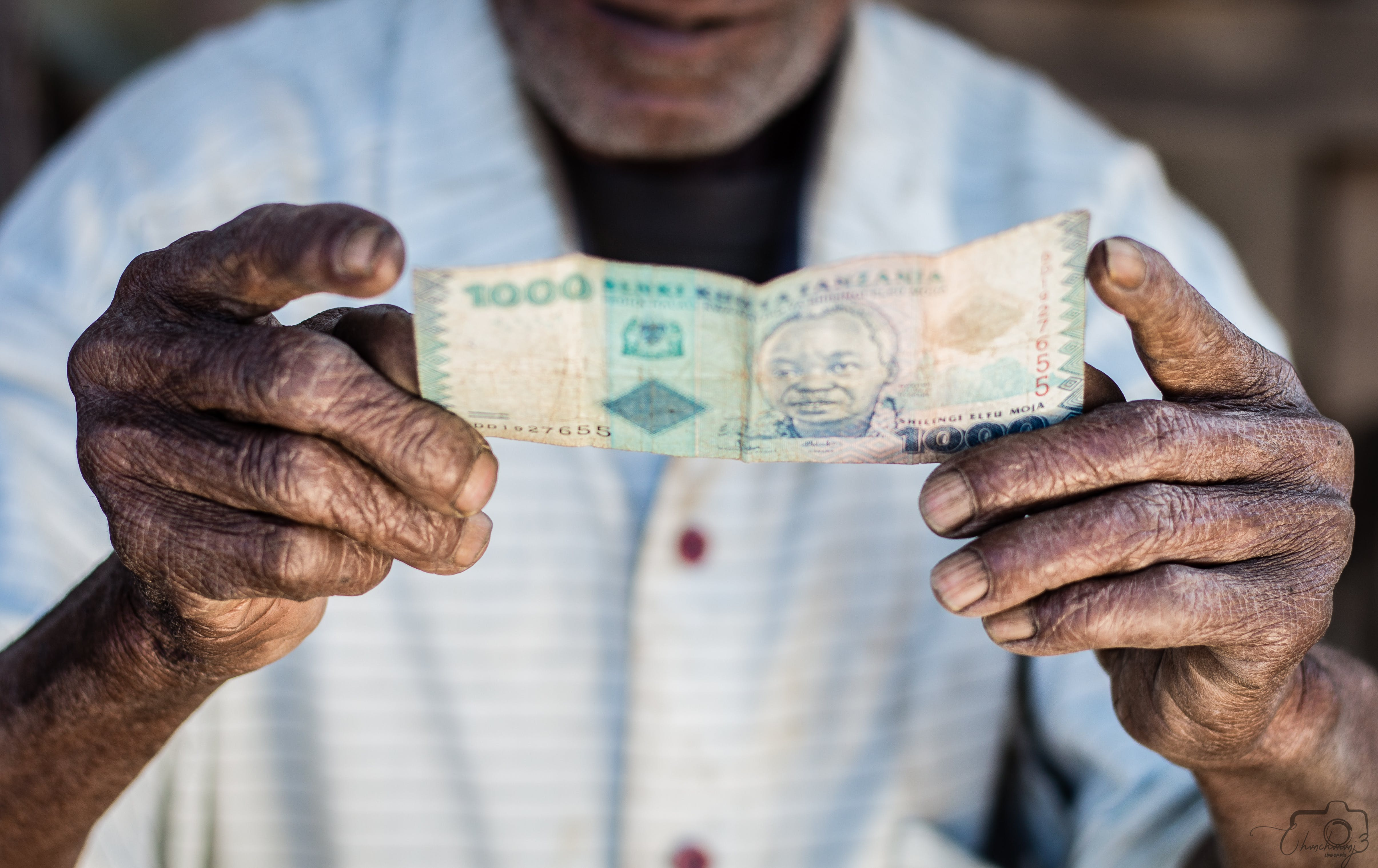 Close-Up Photo Of Person Holding Banknote