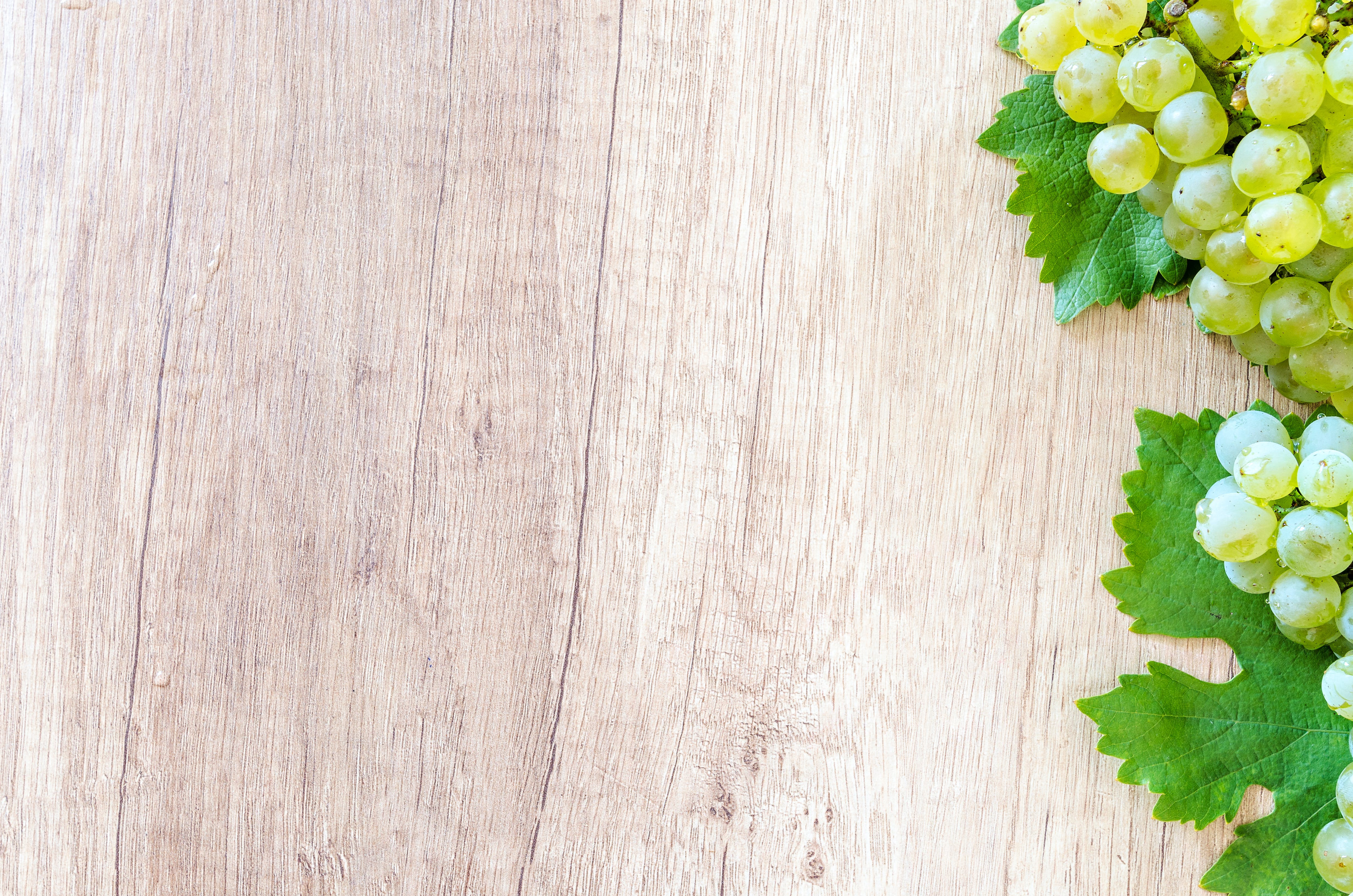 Green Grapes on Brown Wooden Panel