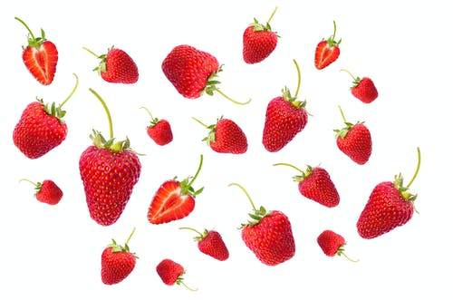 Red Strawberries Scattered on Air