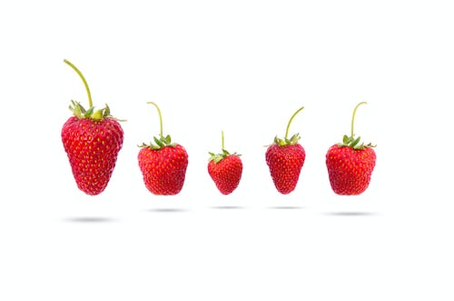 Five Assorted-shape Strawberries Floating on Mid Air