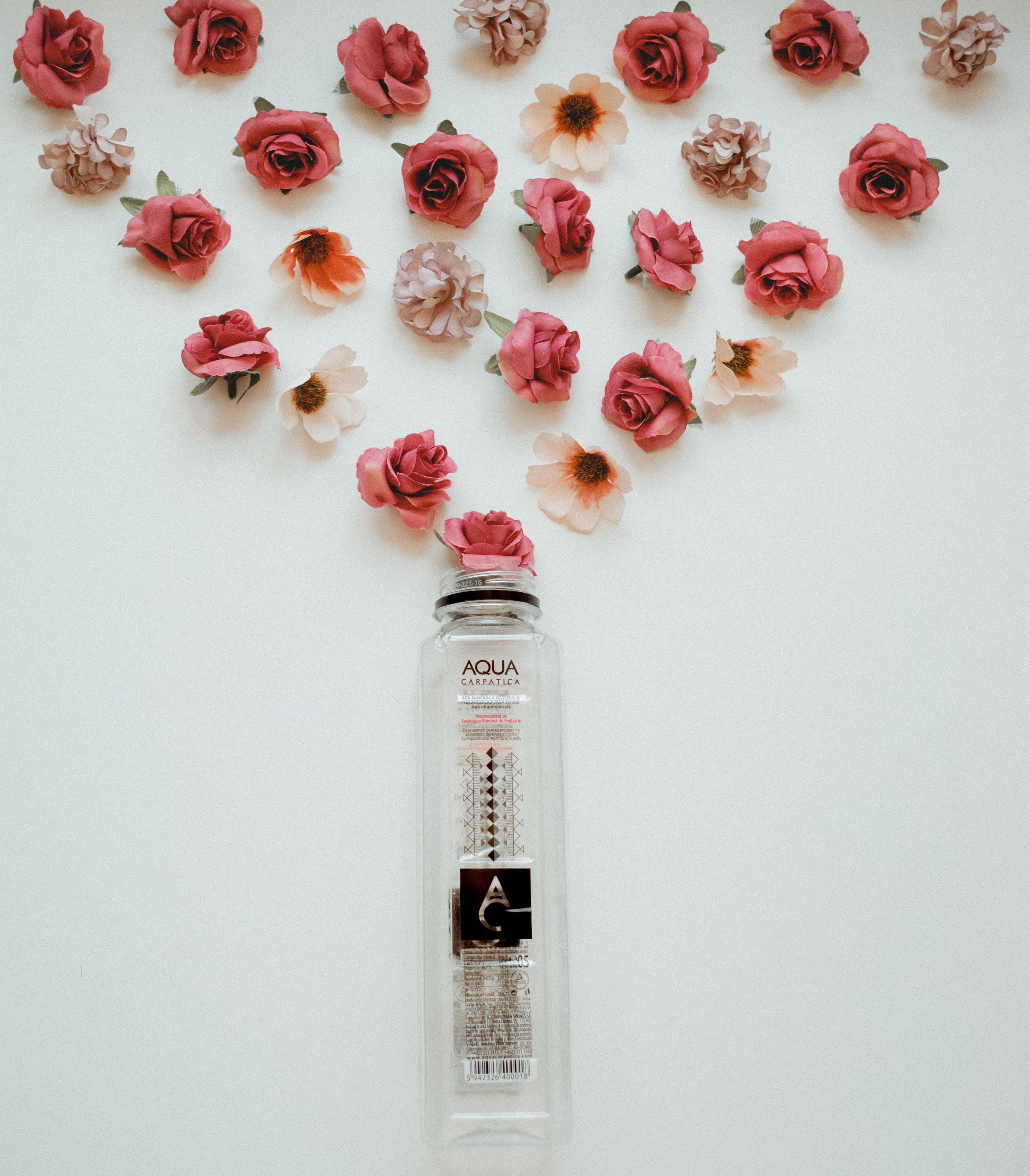 Aqua Fragrance Bottle and Roses Wall Decor