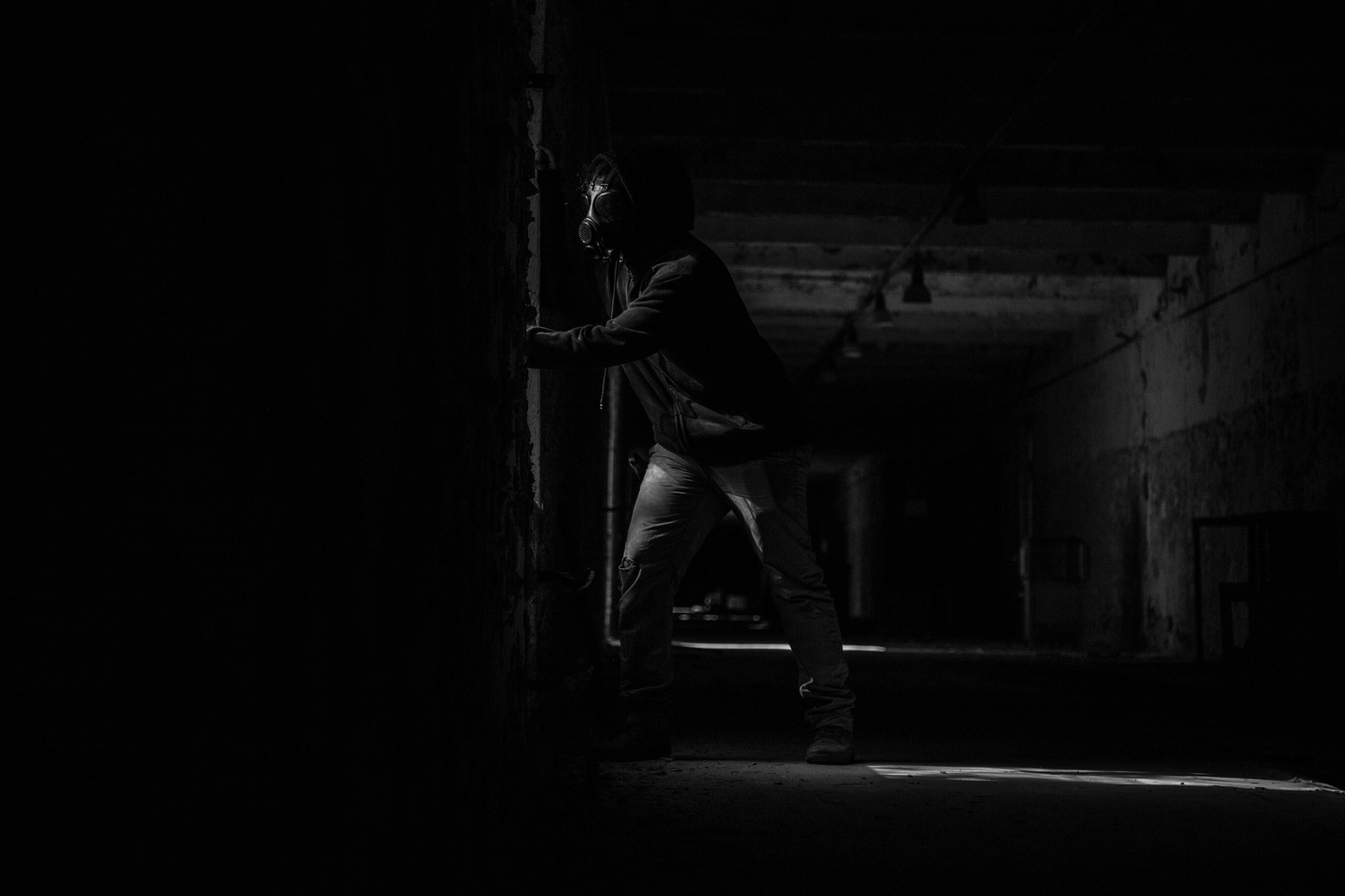 Person Wearing Mask Inside Dark Room