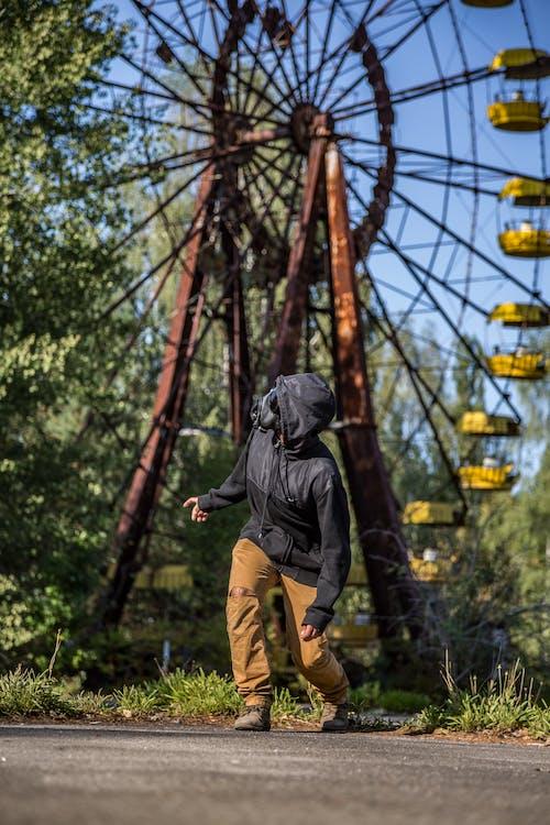 Person Standing Near Ferris Wheel