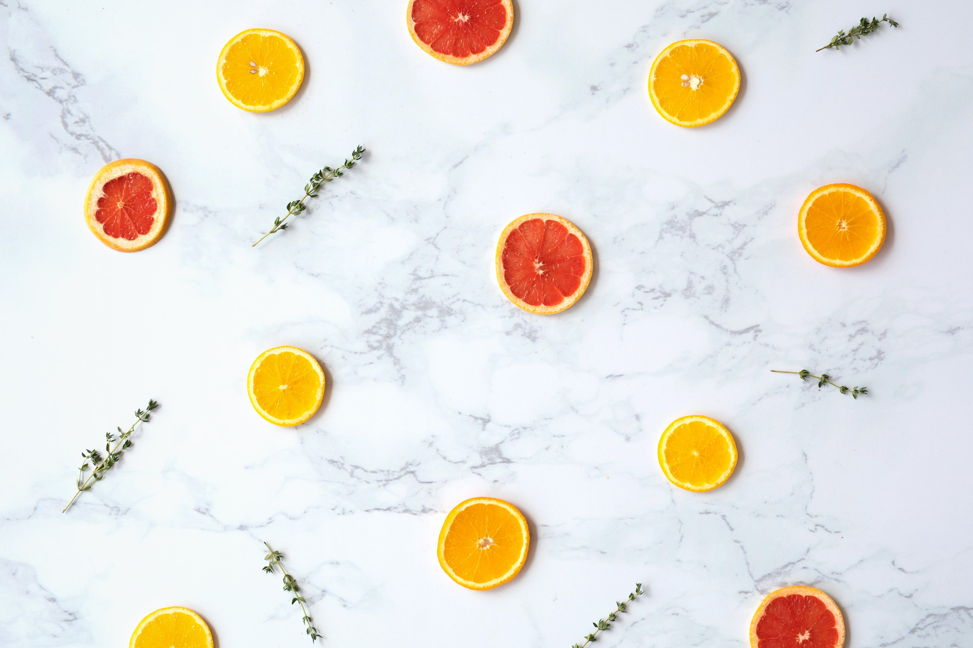 Flatlay Photography Of Sliced Citrus Fruits On Marble Surface