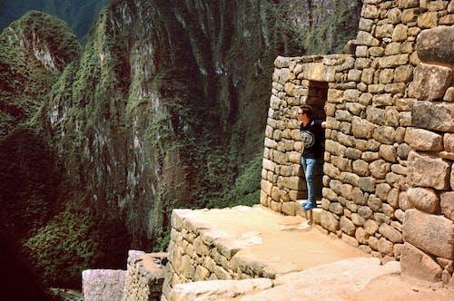 Person Standing on Door