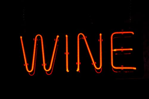 Red Wine Led Signage With Black Background