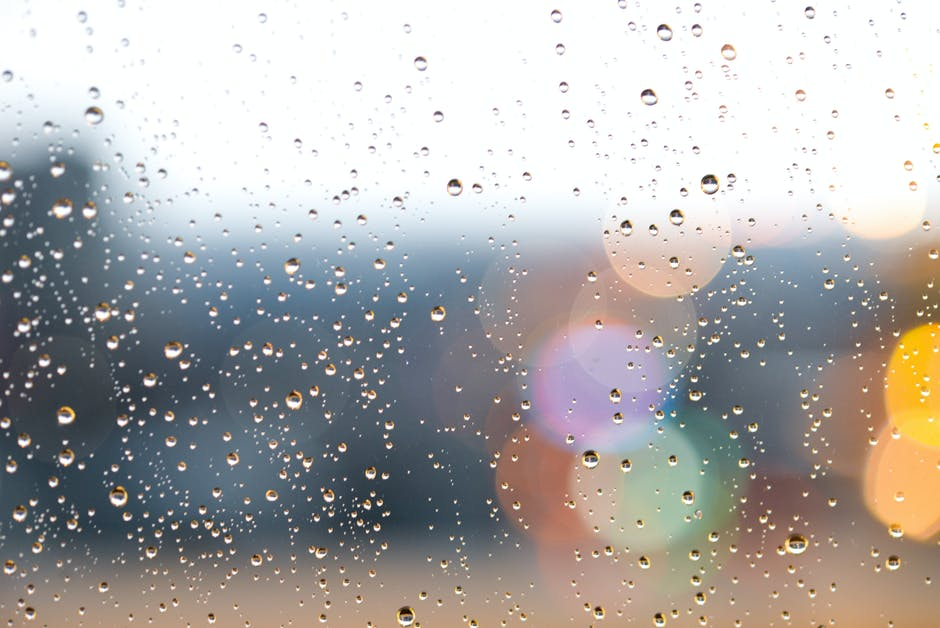 Close up photography of droplets on glass